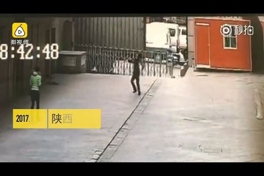 Mr Li Guowu had tried to catch the woman who jumped from the 11th floor, but was killed by the impact.