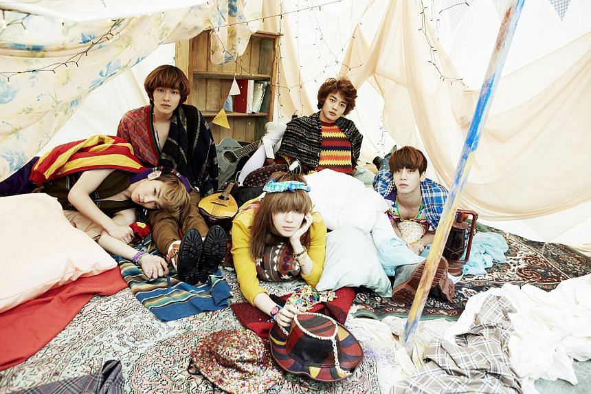 Shinee members (clockwise from front centre) Tae Min, Key, Onew, Min Ho and Jong Hyun.