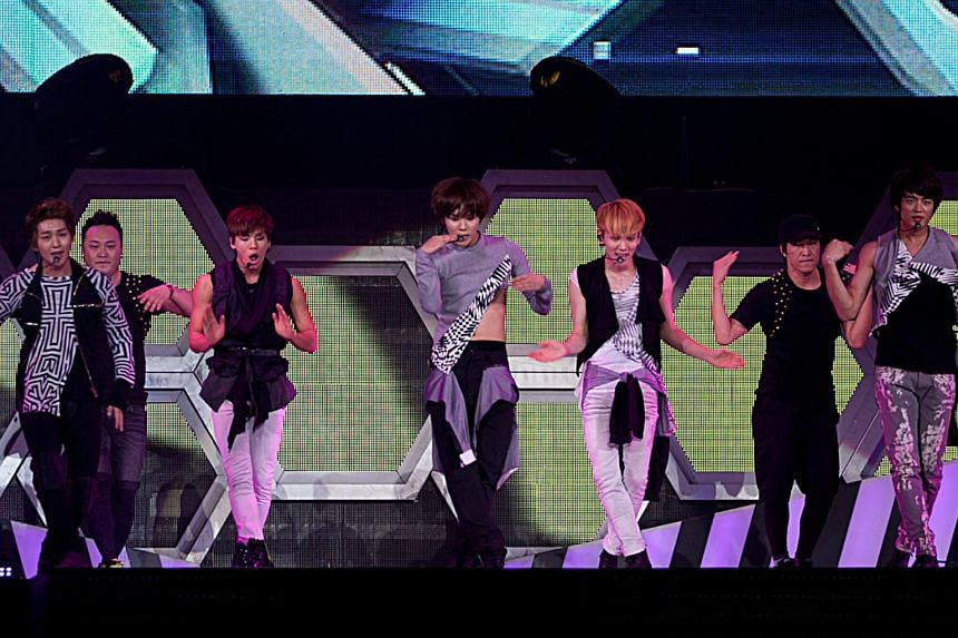 K-pop group Shinee, comprising (from left) Onew, Kim Jong Hyun, Lee Tae Min, Key and Choi Min Ho, performing at the Singapore Indoor Stadium on Dec 8, 2012.