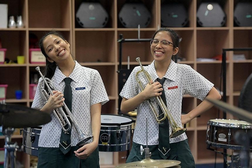 Twins Heevah (left) and Heerah Judd Mohamad Said scored Grade 1 in both mathematics and combined science in the GCE N levels. The 17-year-old sisters, who are in Normal (Academic), had jumped from Normal (Technical) at the end of Sec 2.