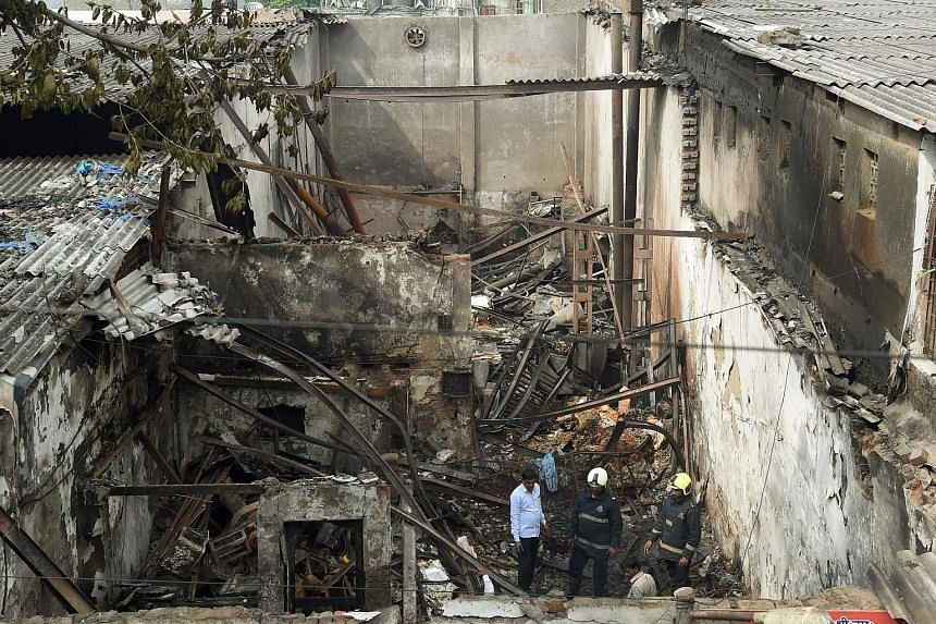 The authorities in Mumbai are investigating the blaze which destroyed a sweet shop, killing 12 and injuring four.