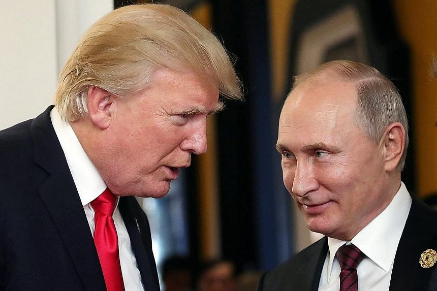 US President Donald Trump and his Russian counterpart Vladimir Putin at the Apec summit in Danang, Vietnam, on Nov 11. Mr Putin called Mr Trump on Sunday to thank him for information from the CIA that allowed Russia's law enforcement agencies to deta