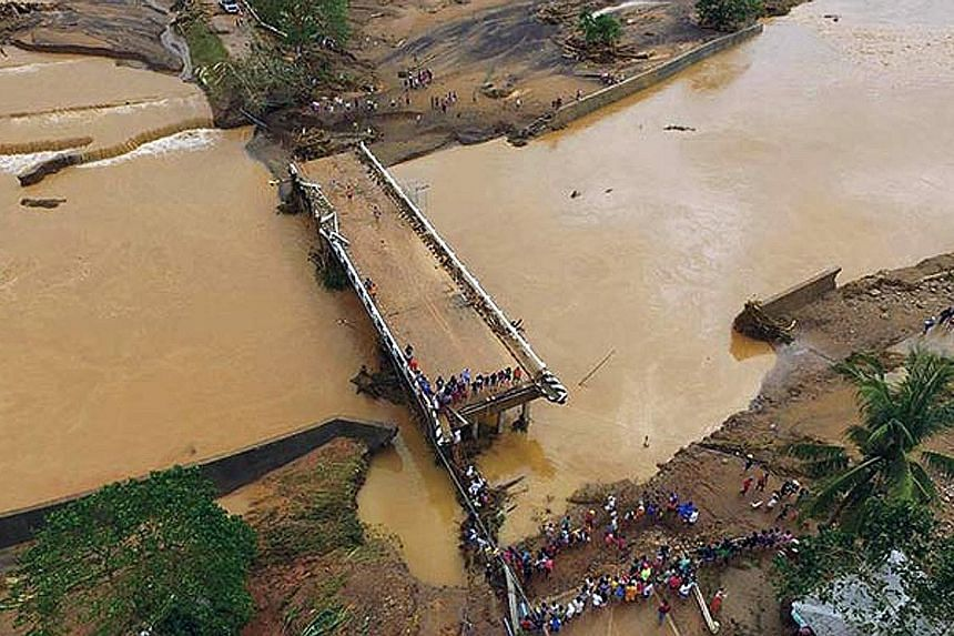 A bridge in the town of Naval damaged after Tropical Storm Kai-Tak pounded the island province of Biliran in the Philippines as it made its way across the archipelagic nation over the weekend. The heavy rain caused landslides that buried many homes a