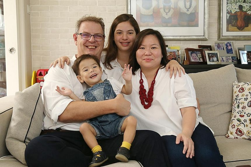 Mr Brendan Hanson and Ms Tan Soo Lin with their children Emma Wen Xuan and Oliver Shan Yu. The boy was born premature at 25 weeks, weighing just 580g.