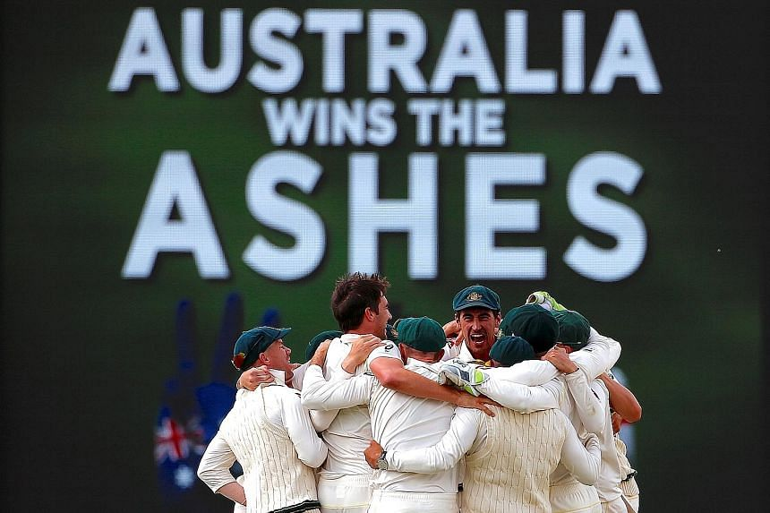 Left: Australian players celebrate regaining the Ashes after winning the third Test in Perth - the final Ashes Test to be played at the Waca Ground in Perth. Below: The writing is on the wall when England's Jonny Bairstow is bowled for 14 with the ve