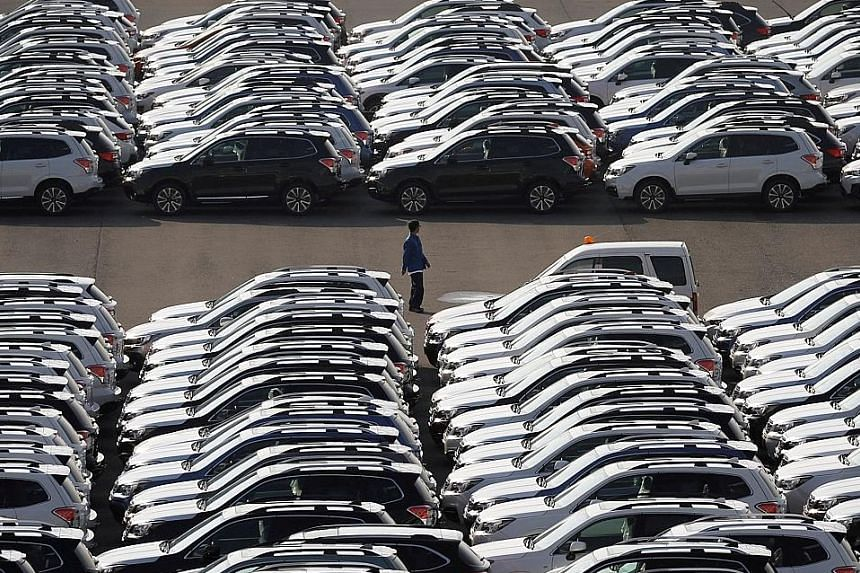 Made-in-Japan cars waiting to be exported at Yokohama's port. Data from the Ministry of Finance shows Japanese exports grew 16.2 per cent in the year to November.