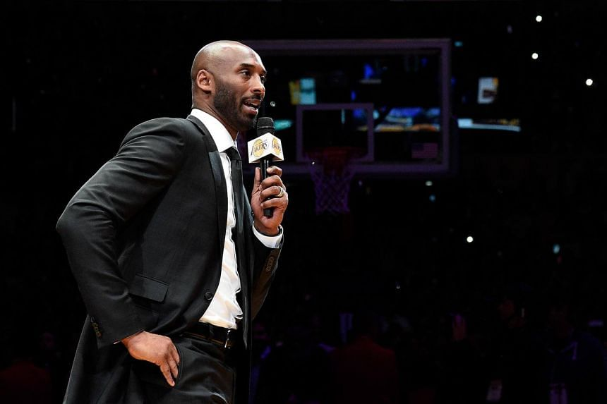 Kobe Bryant addresses the crowd at halftime as both his #8 and #24 Los Angeles Lakers jerseys are retired at Staples Center on Dec 18, 2017 in Los Angeles, California.