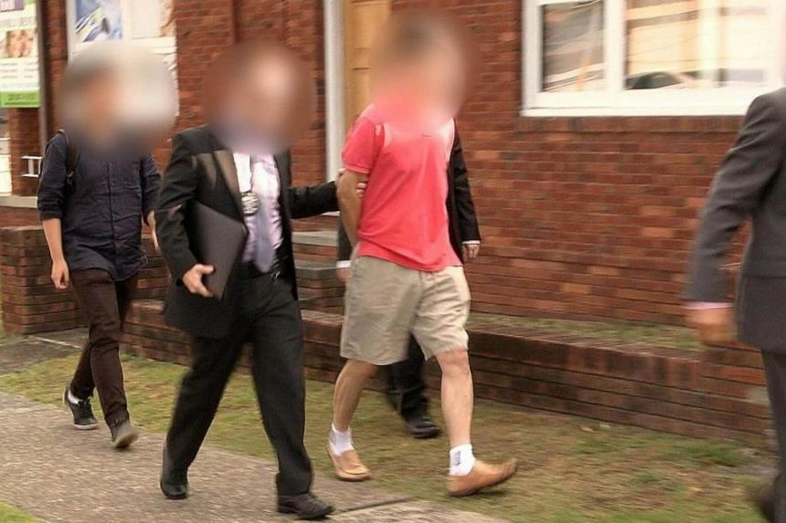 Australian Federal Police officers arresting a man who is said to have tried to broker the sale of missile components, as well as attempted to sell coal to third parties in Indonesia and Vietnam.