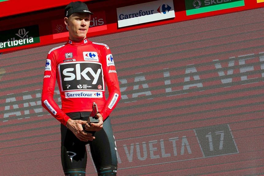 A file photo of Chris Froome with the leader's red jersey at the end of the 3rd stage of the 72nd edition of La Vuelta Tour of Spain cycling race, on Aug 21.