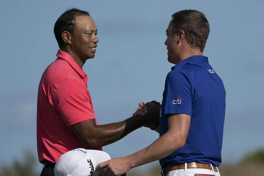 Tiger Woods (left) shakes hands with Justin Thomas on the 18th hole after the final round of the Hero World Challenge golf tournament at Albany, on Dec 3.