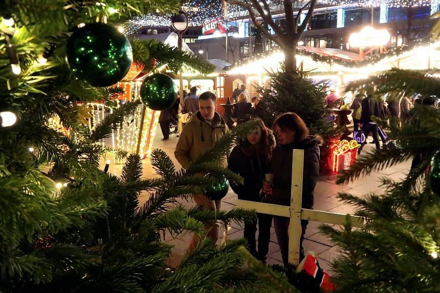 People visit the memorial to the victims of the 2016 Christmas market attack, on Dec 18, 2017.