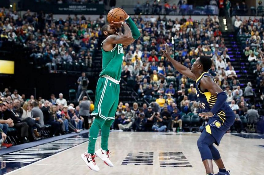 Kyrie Irving shoots the ball during the game against the Indiana Pacers at Bankers Life Fieldhouse.