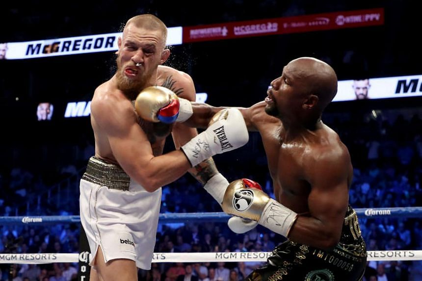 The last time Conor McGregor (left) fought was when he stepped into the ring at the T-Mobile Arena in Las Vegas to take on Floyd Mayweather Jr (right).