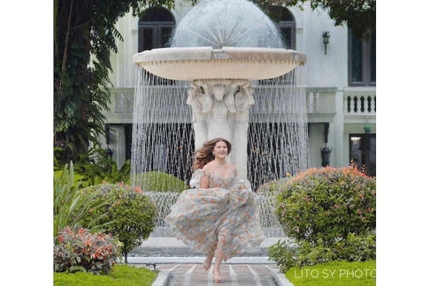A third photo showed her in a floral dress before the fountain at the Palace's grounds.