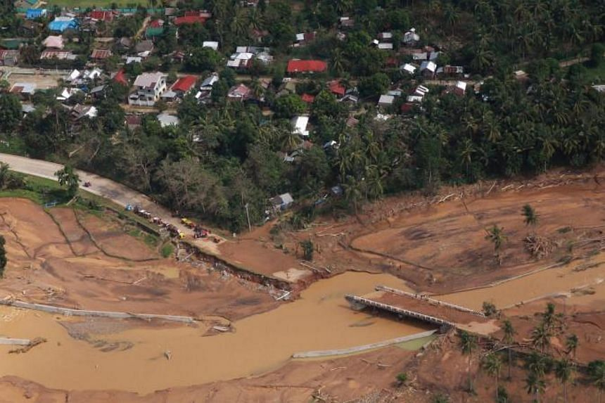 A bridge damaged after a flash flood brought about by heavy rains, triggered by Tropical Storm Kai-Tak, as seen from the presidential helicopter in Catmon town, Biliran province, in central Philippines.