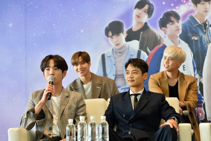 SHINee singer Kim Jong Hyun (top right) was in Singapore with the rest of SHINee and South Korean girl group Red Velvet as ambassadors of South Korean duty-free retailer The Shilla Duty Free at Changi Airport's Terminal 4 (T4).