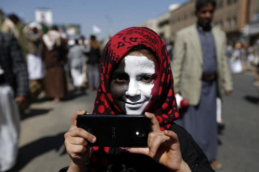 A Yemeni youth takes part in a demonstration calling for the Saudi-led coalition's blockade to be lifted, on Nov 13, 2017, in the rebel-held capital Sanaa.