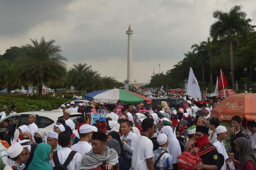 Indonesians gather ahead of a protest against US President Donald Trump's recent decision to recognise Jerusalem as the capital city of Israel, at the US embassy in Jakarta on Dec 17, 2017.
