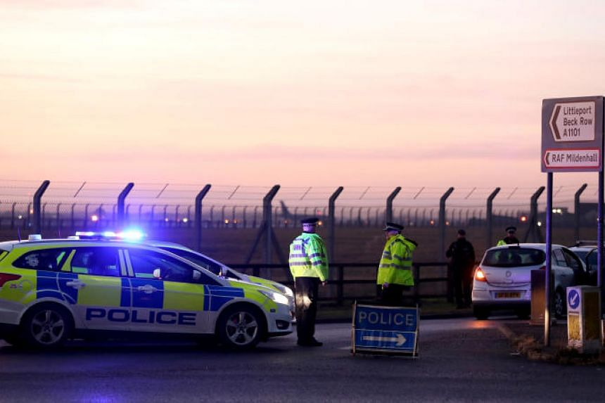 British police stand guard at the entrance to the US Air Force base at RAF Mildenhall, Suffolk, Britain on Dec 18, 2017.