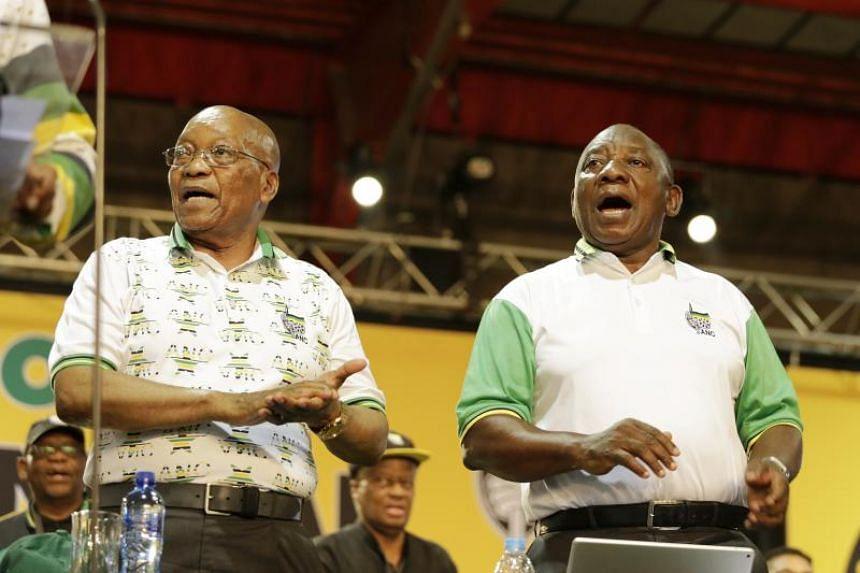 ANC Presidential hopeful Cyril Ramaphosa (right) and outgoing ANC president Jacob Zuma (left) sing and dance as they await results of the presidential race during the 54th ANC National Conference held at the NASREC Convention Centre, Johannesburg , S