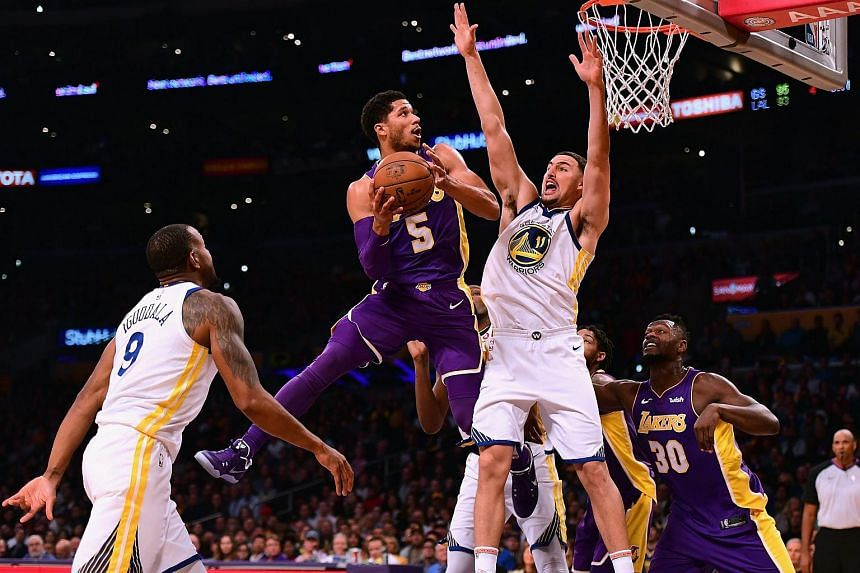 Josh Hart (centre) of the Los Angeles Lakers attempts a shot in front of Klay Thompson (second from right) of the Golden State Warriors during a 127-123 Warriors win in ovetime at Staples Center on Nov 29, 2017 in Los Angeles, California.