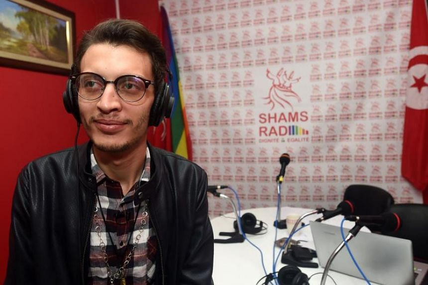 Bouhdid Belhadi, director of Shams Radio, the first LGBT radio in the Arab region, in the studio prior to doing a live broadcast during the opening of the radio station on Dec 18, 2017 in Tunis.