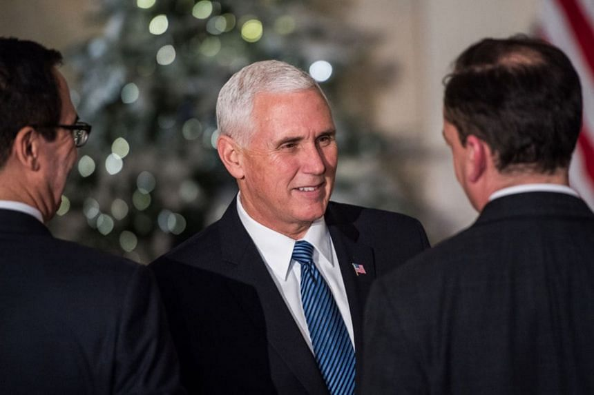 Vice-President Mike Pence's office said the trip was being delayed so he can stay in Washington until votes on the tax cut legislation are completed.