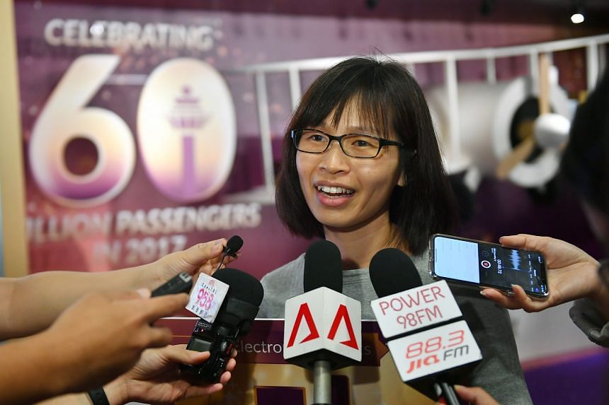 Housewife Ang Bee Leng, 45, who was on the Scoot flight yesterday, came in first in a quiz held to celebrate Changi Airport's achievement. She won a trip to Jaipur, India, and Apple products.