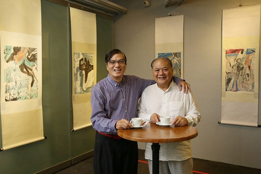 Merlin Gallery director Johnny Quek (left in white, with Mr David Chen, third son of painter Chen Wen Hsi) hopes to encourage people to let him help authenticate their Chen Wen Hsi paintings.