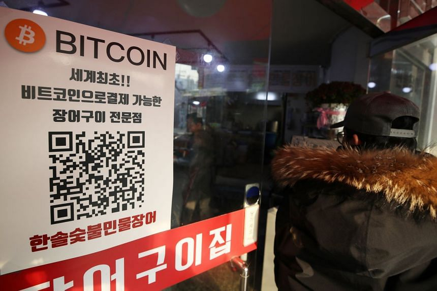 A restaurant shows a bitcoin sign as a payment option in Seoul, South Korea.