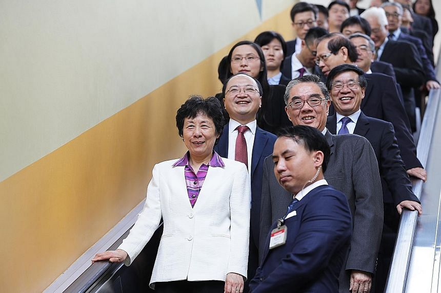 Madam Yan Junqi with members of the Chinese delegation and RSIS staff yesterday, including Mr Ong Keng Yong (beside her); Mr Fang Xinwen (behind her), charge d'affaires of the Chinese Embassy in Singapore; and Mr Liu Hongcai (behind Mr Ong), deputy h