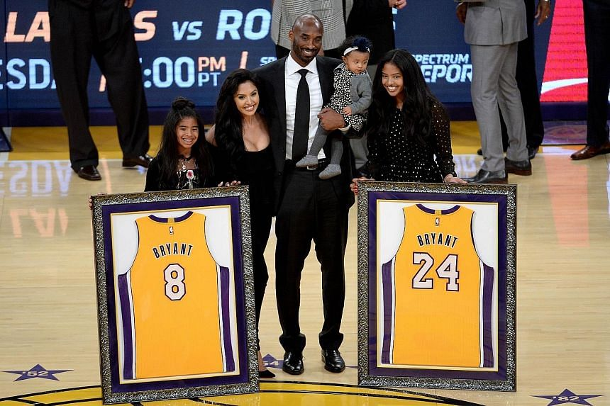 Kobe Bryant with his family during the half-time ceremony, where both his LA Lakers numbers were retired at Staples Centre.