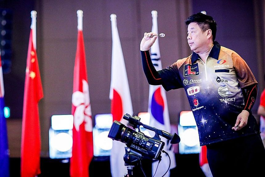 Singapore darts player Paul Lim lining up for a throw at the World Cup of Darts in June, when Lim and his partner Harith Lim reached the quarter-finals and knocked out top seeds Peter Wright and Gary Anderson.