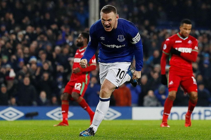 Wayne Rooney celebrates scoring Everton's third goal from the spot, his second penalty in the 3-1 Premier League win over Swansea. His first was saved by Lukasz Fabianski who pushed it onto the post, but Dominic Calvert-Lewin tapped in the rebound to
