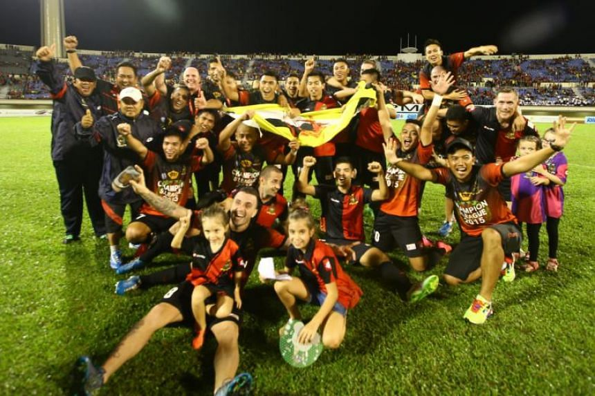 Brunei DPMM team celebrating after winning the S.League trophy at Hassanal Bolkiah Stadium on Nov 21, 2015.