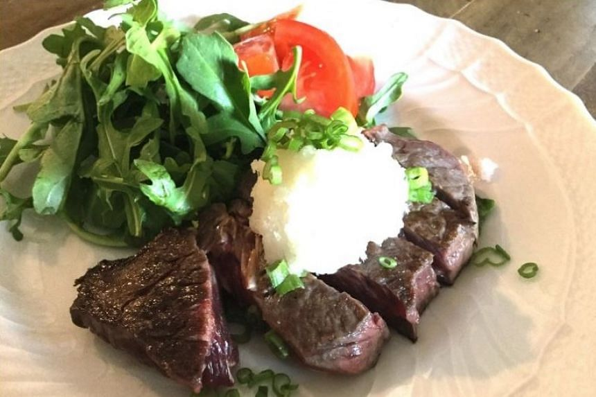 Japanese-style steak with grated daikon and citrus sauce.