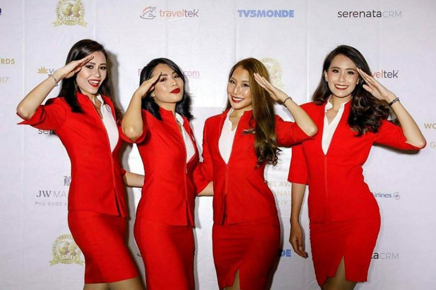 """The """"eye-catching outfits"""" of budget airlines Firefly and AirAsia (above) do not reflect the status of Islam as the official religion of Malaysia, said Senator Abdullah Mat Yasim."""