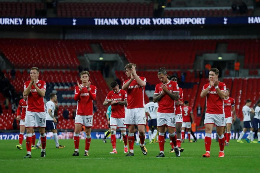 Barnsley players applaud fans after the Carabao Cup third round match against Tottenham Hotspur at Wembley Stadium in London on Sept 19, 2017.