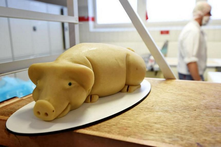 A pig made of fresh marzipan seen at the headquarters of the traditional confectionary maker JG Niederegger GmbH in Luebeck, Germany.