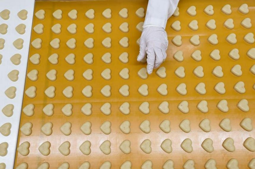 Heart-shaped marzipan passing along a conveyor belt at the headquarters of the traditional confectionary maker JG Niederegger GmbH in Luebeck, Germany.