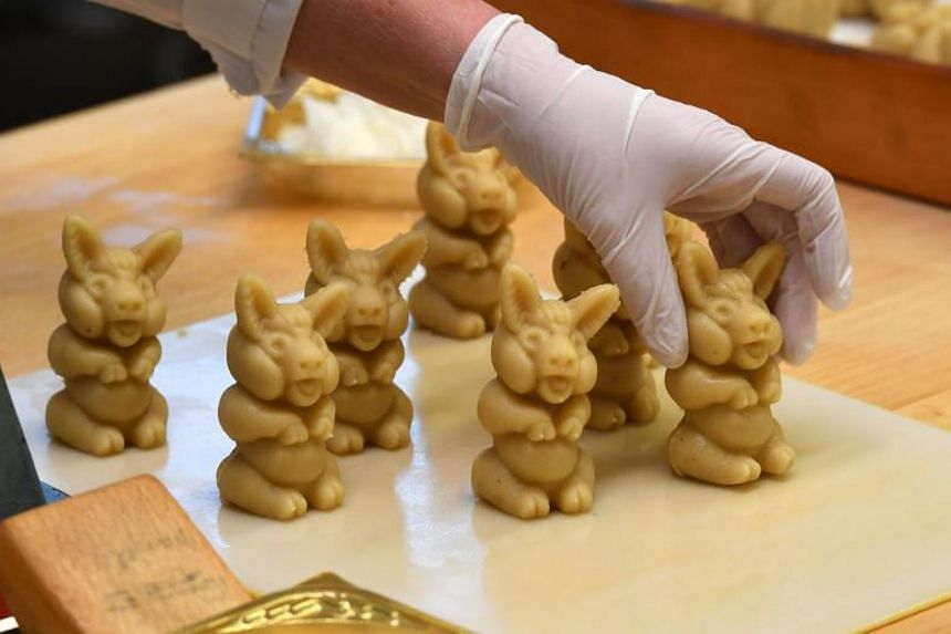 An employee preparing pigs made of fresh marzipan at the headquarters of the traditional confectionary maker JG Niederegger GmbH in Luebeck, Germany.