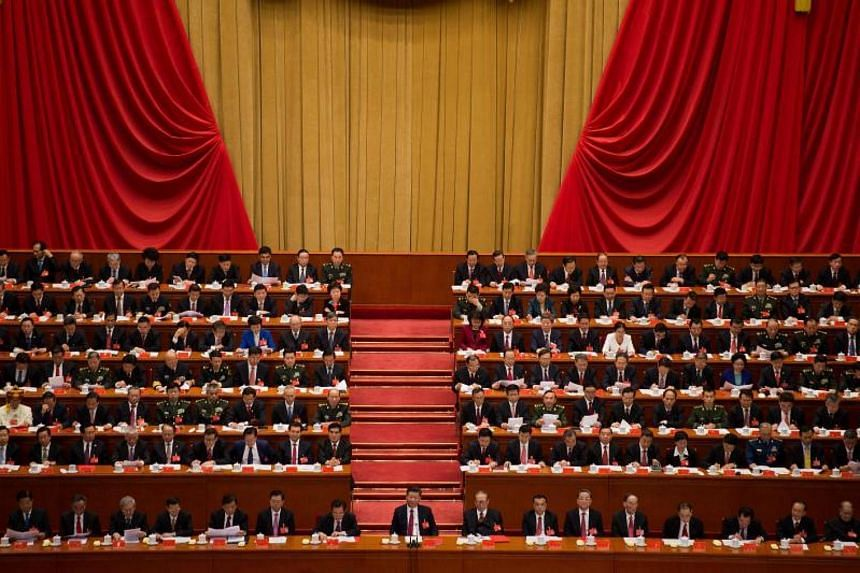 Delegates at the closing of the 19th Communist Party Congress at the Great Hall of the People in Beijing on Oct 24, 2017.