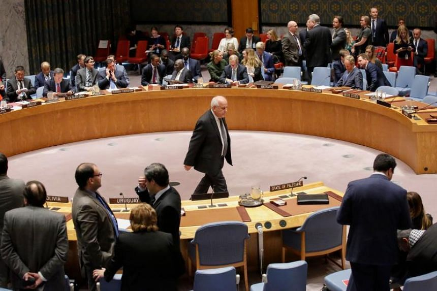 Palestine's Ambassador to the United Nations Riyad Mansour (centre) walks through the room before a vote on a draft resolution that would reject Trump's decision to recognise Jerusalem as the capital of Israel on Dec 18, 2017, at UN Headquarters in N