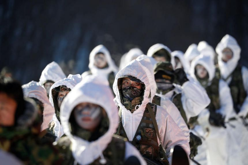 South Korean and US Marines take part in a winter military drill in Pyeongchang, South Korea, on Dec 19, 2017.