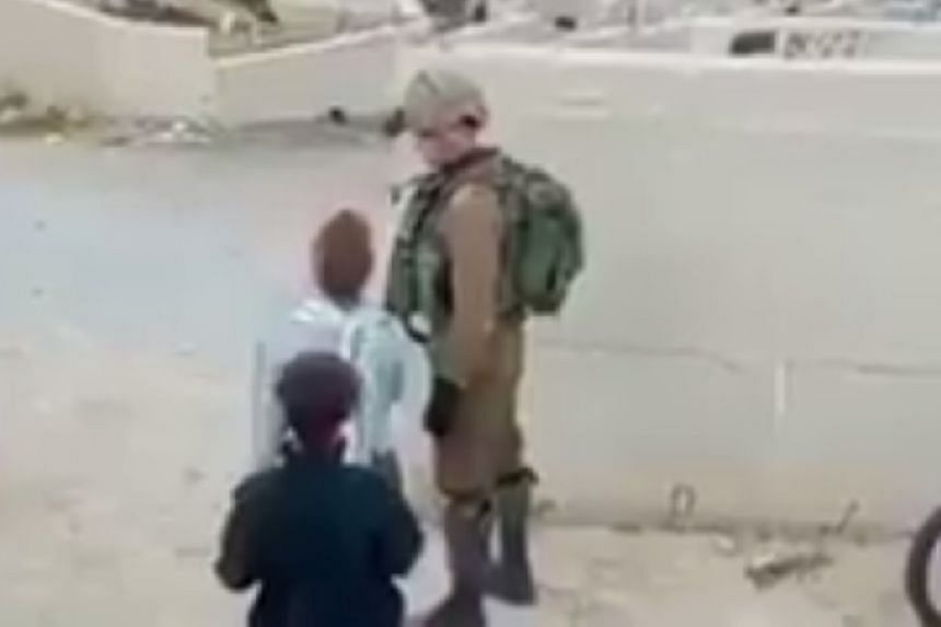 A screenshot from the video of the teenage girls antagonising Israeli soldiers.