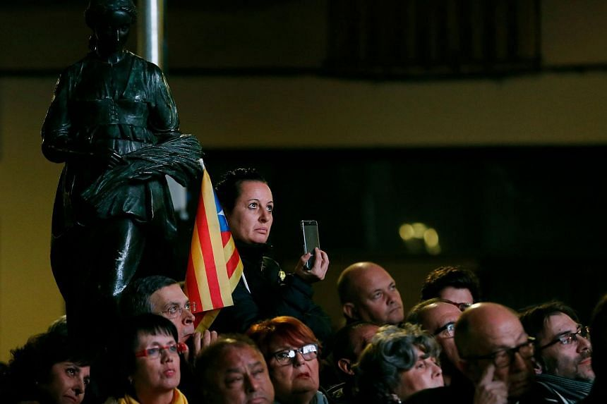 People attend the Junts per Catalonia (All for Catalonia) grouping final campaign meeting for the upcoming Catalan regional election.