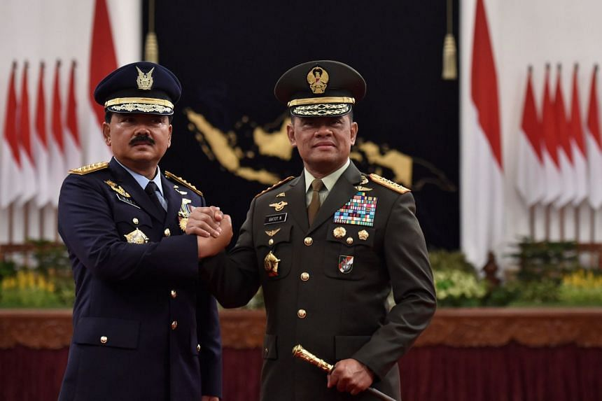Former Indonesian military commander Gatot Nurmantyo (right) and new Armed Forces Chief Marshall Hadi Tjahjanto at an inauguration ceremony, on Dec 8.