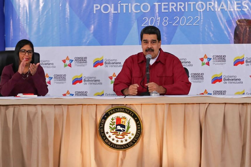 Venezuelan leftist President Nicolas Maduro accused the US of being behind the assault on a military unit from which 26 rifles were stolen.