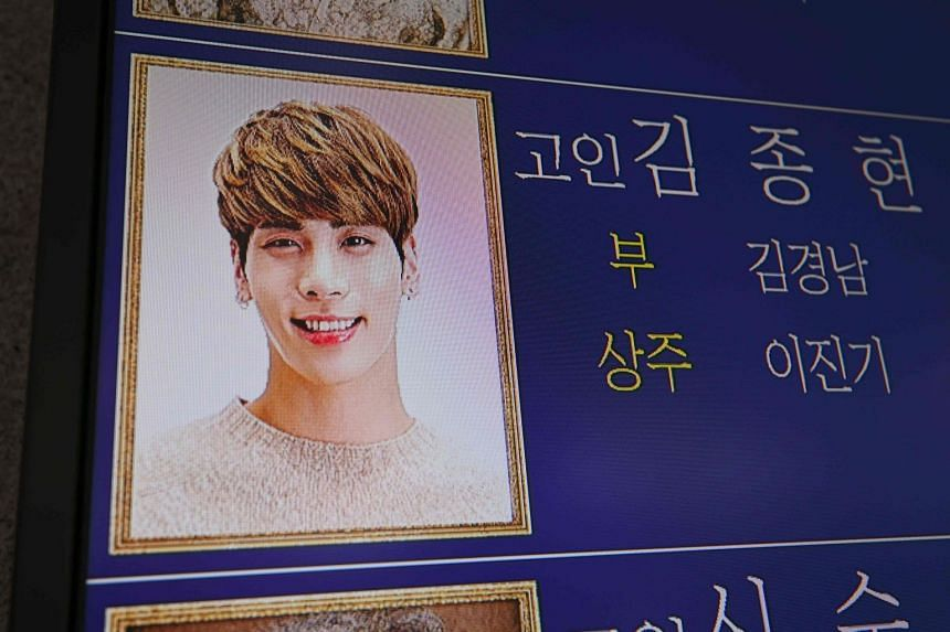 Kim Jong Hyun's photo is displayed on an electronic board outside a funeral hall at a hospital in Seoul, on Dec 19, 2017.
