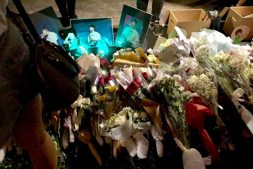 Flowers, photographs and other items left by fans at the memorial service for SHINee's Jonghyun.